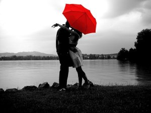 Romantic kiss, red umbrella